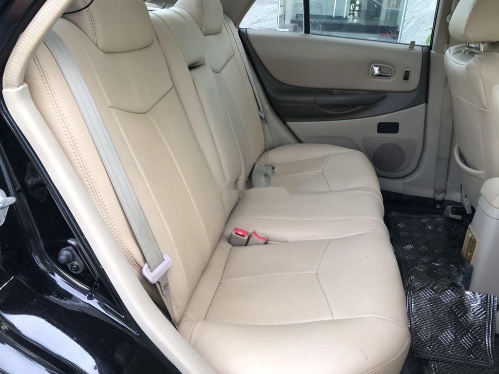 Cần bán xe Ford Laser 2004, màu đen, số tự động (7)
