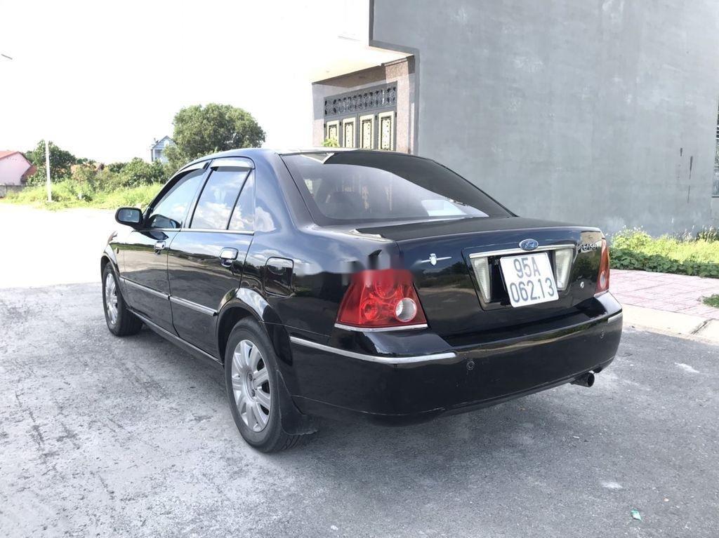 Cần bán xe Ford Laser 2004, màu đen, số tự động (2)