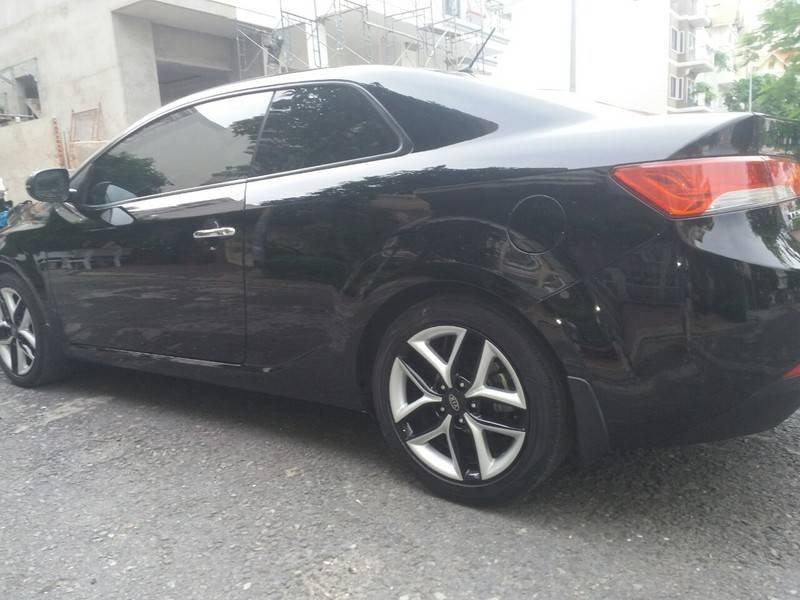 Cần bán xe Kia Cerato 2011, màu đen, xe nhập (1)