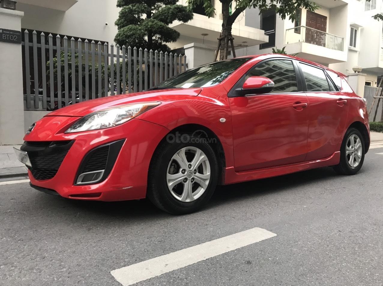 Cần bán Mazda 3 Hatchback 2010 màu đỏ chính chủ (3)
