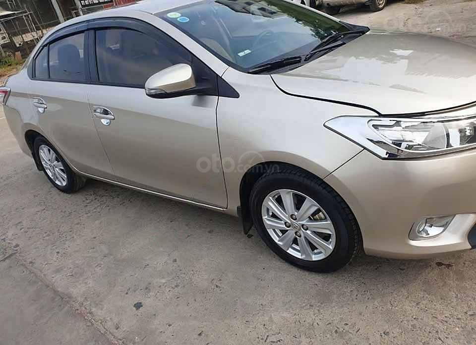 Cần bán xe Toyota Vios E sản xuất 2015, màu vàng còn mới (3)