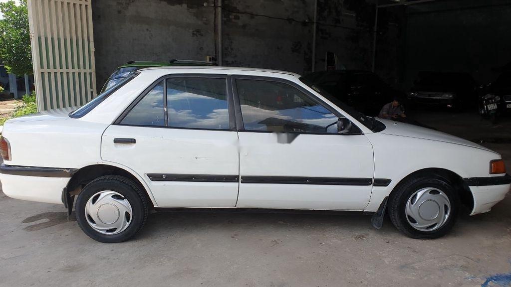 Bán lại xe Mazda 323 đời 1995, màu trắng, xe nhập, đồng sơn ok (5)
