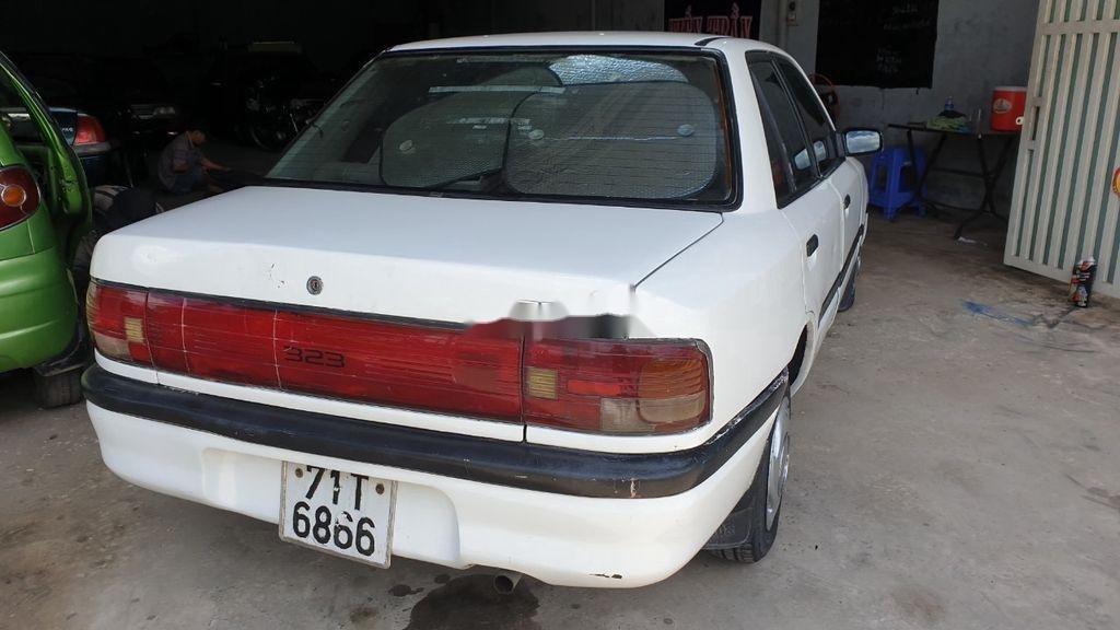 Bán lại xe Mazda 323 đời 1995, màu trắng, xe nhập, đồng sơn ok (1)