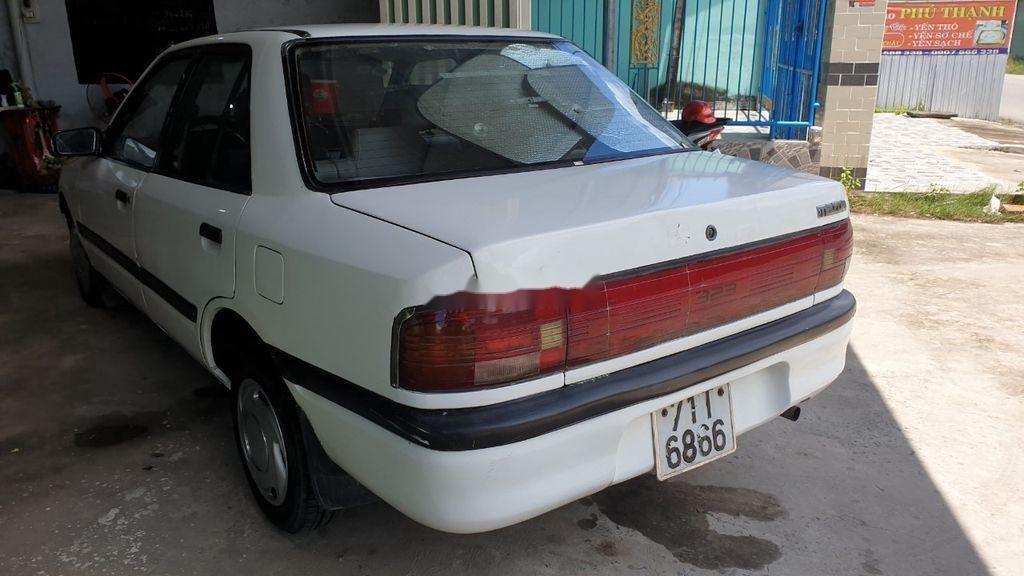 Bán lại xe Mazda 323 đời 1995, màu trắng, xe nhập, đồng sơn ok (6)