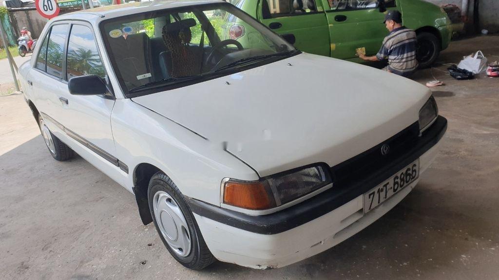 Bán lại xe Mazda 323 đời 1995, màu trắng, xe nhập, đồng sơn ok (4)