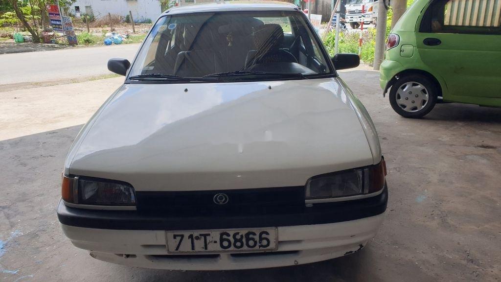 Bán lại xe Mazda 323 đời 1995, màu trắng, xe nhập, đồng sơn ok (2)