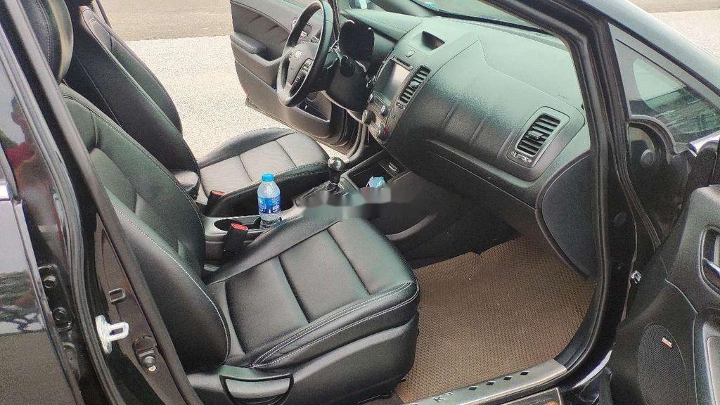Cần bán xe Kia K3 đời 2015, màu đen còn mới (6)