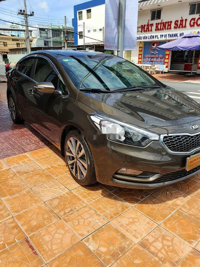 Bán Kia K3 năm sản xuất 2015, màu nâu, xe cũ chính hãng (3)