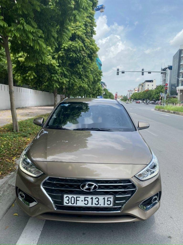 Cần bán lại xe Hyundai Accent 1.4 AT đời 2018, màu vàng cát (1)