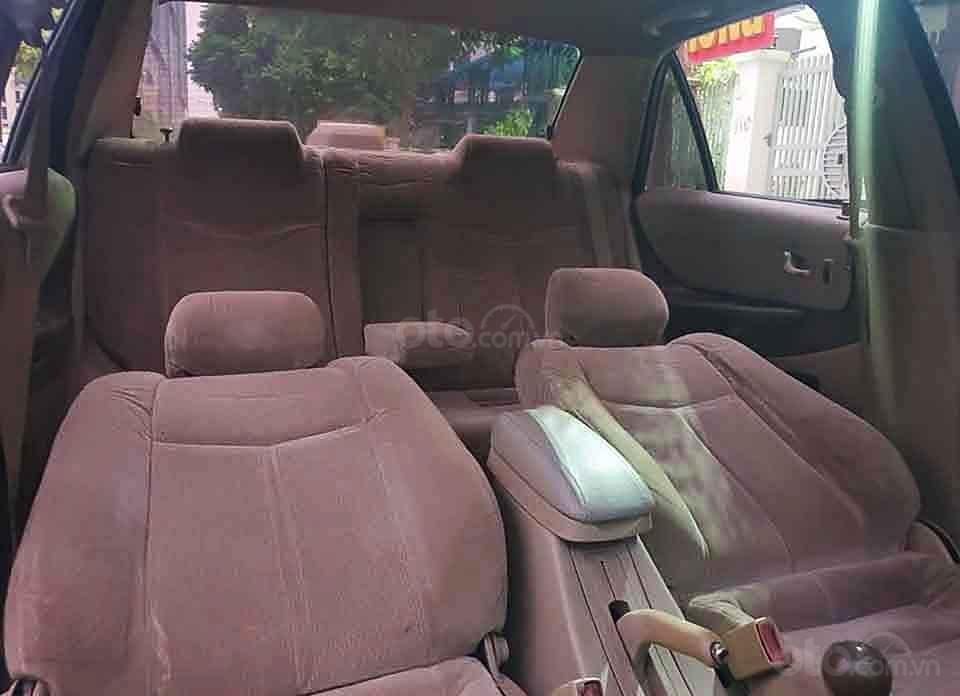 Cần bán xe Ford Laser Ghia 1.8 MT sản xuất năm 2003, màu đen, giá cạnh tranh (2)