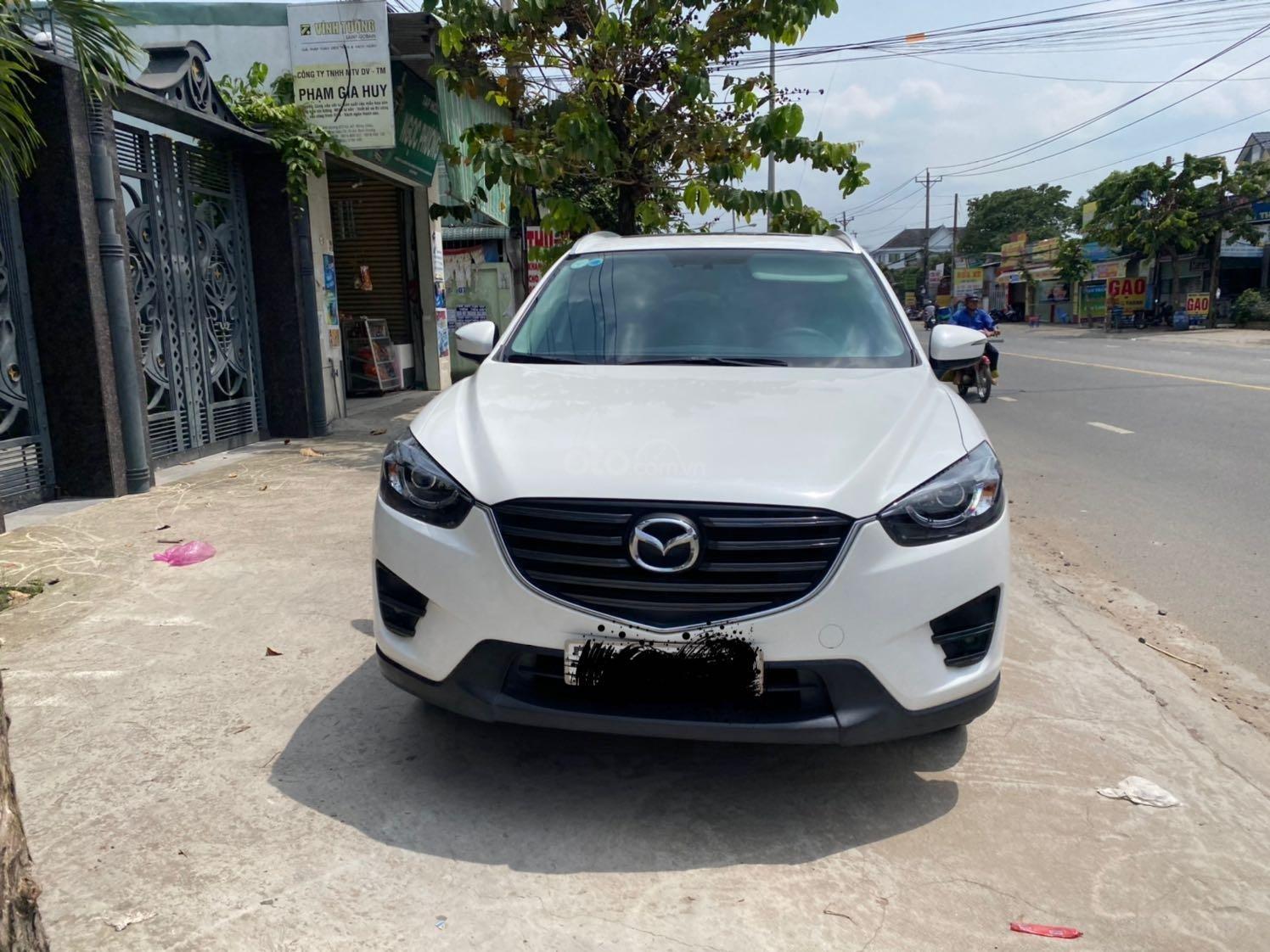 Cần bán xe Mazda CX 5 đăng ký 2016, màu trắng ít sử dụng, giá tốt 708 triệu đồng (1)