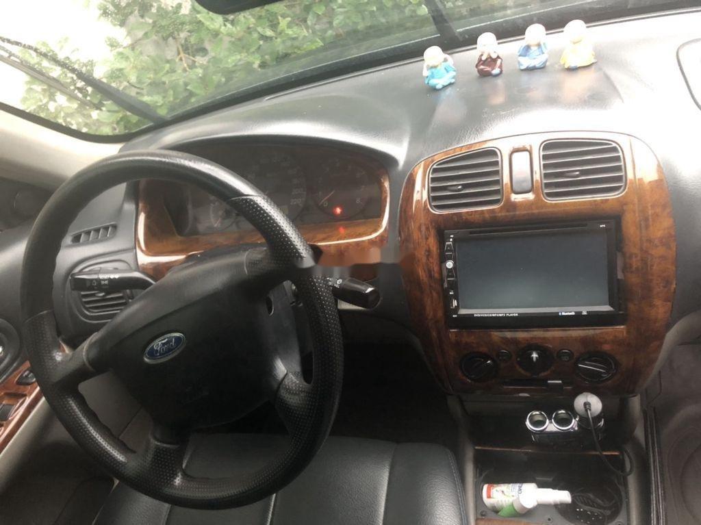 Cần bán Ford Laser sản xuất năm 2003, màu xanh đen, xe nhập (2)