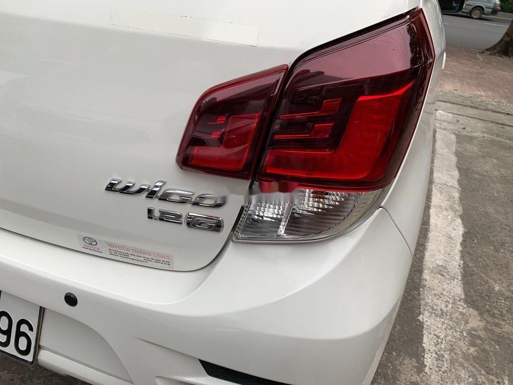 Cần bán lại xe Toyota Wigo sản xuất 2018, màu trắng, số sàn, 290tr (2)