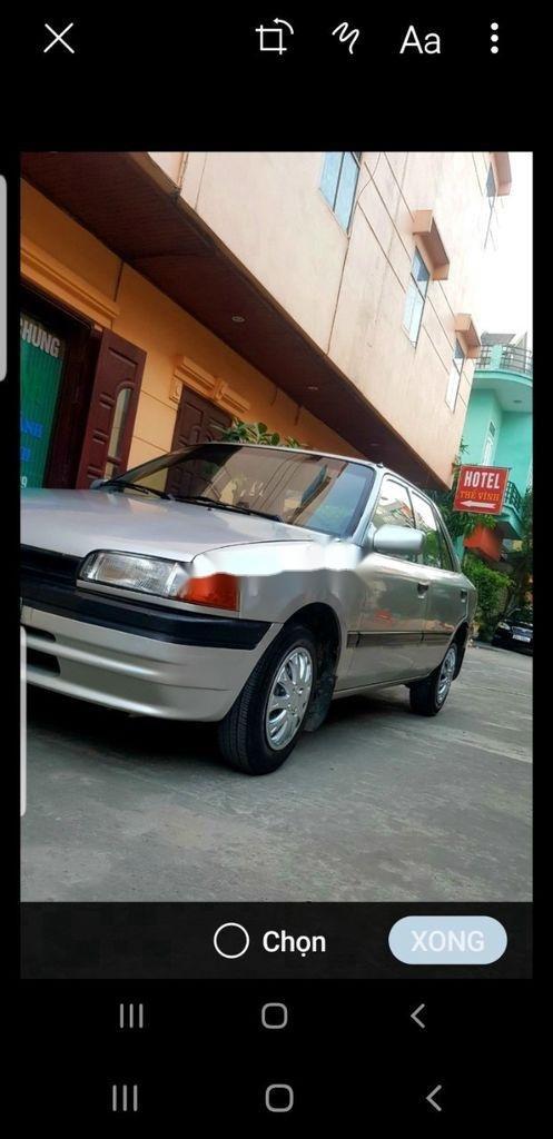 Cần bán gấp Mazda 323 năm sản xuất 1996, xe nhập, giá tốt (1)