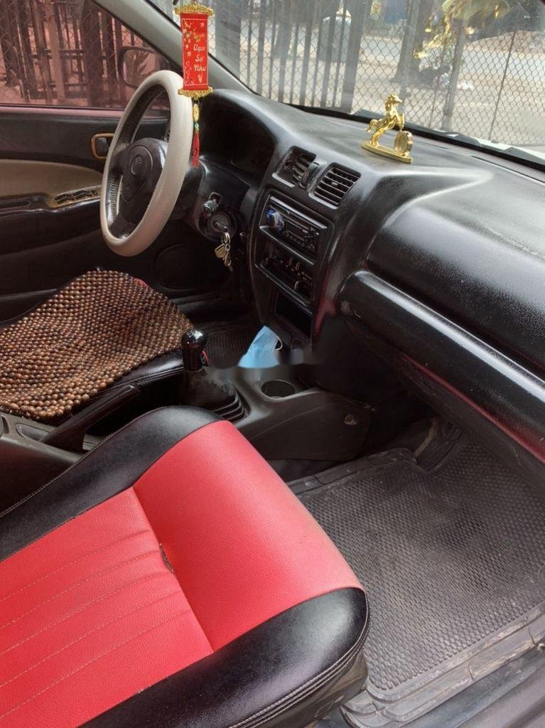 Bán Mazda 323 đời 2000, màu trắng (8)