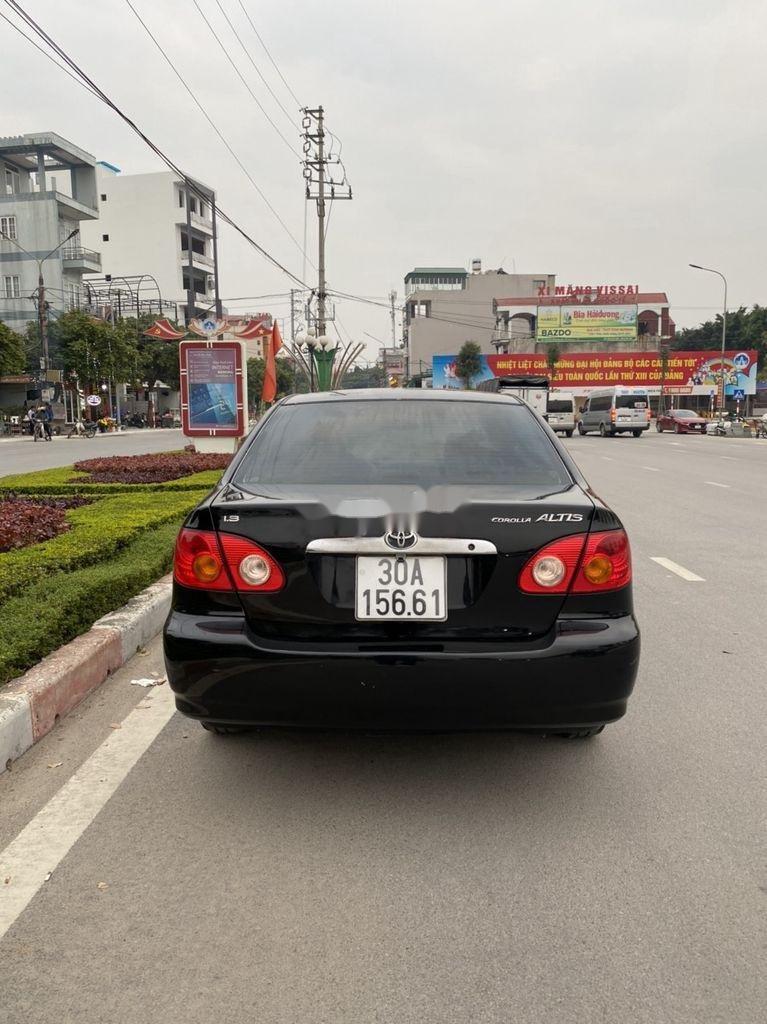 Cần bán lại xe Toyota Corolla Altis đời 2002, màu đen, giá chỉ 198 triệu (7)