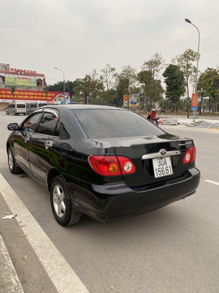 Cần bán lại xe Toyota Corolla Altis đời 2002, màu đen, giá chỉ 198 triệu (2)
