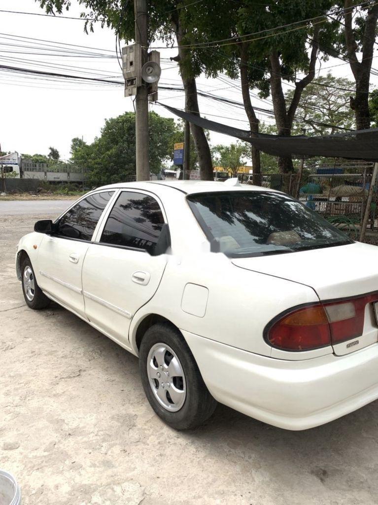 Bán Mazda 323 đời 2000, màu trắng (5)