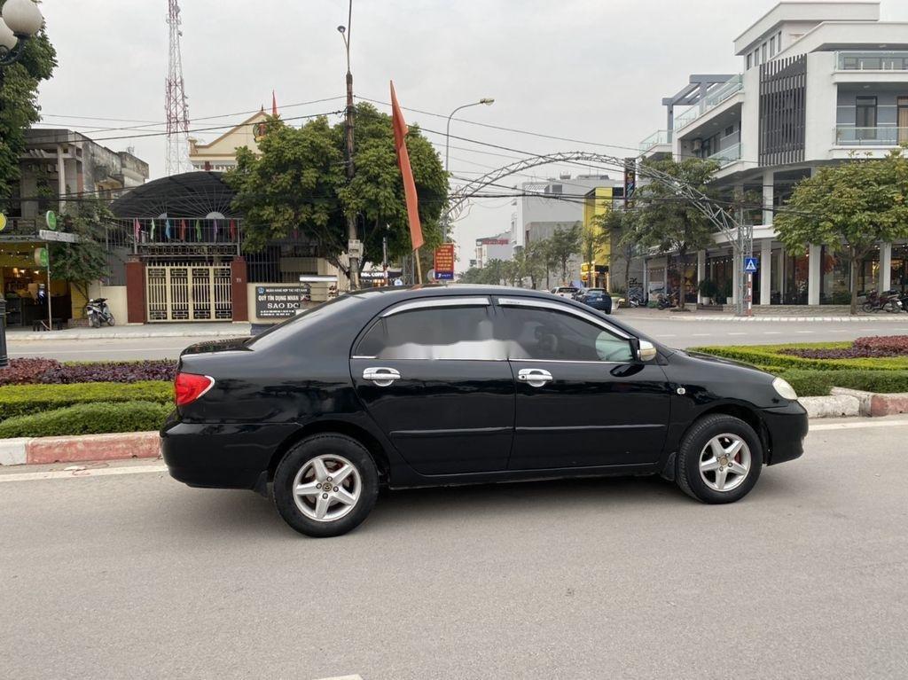 Cần bán lại xe Toyota Corolla Altis đời 2002, màu đen, giá chỉ 198 triệu (9)