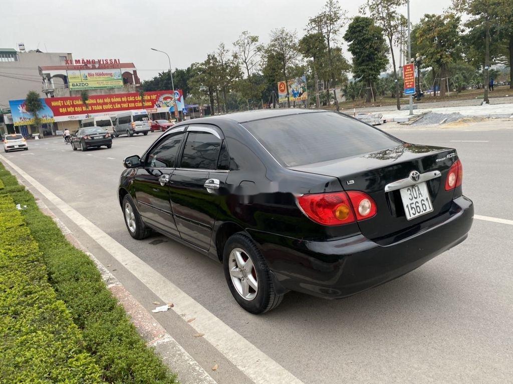 Cần bán lại xe Toyota Corolla Altis đời 2002, màu đen, giá chỉ 198 triệu (10)