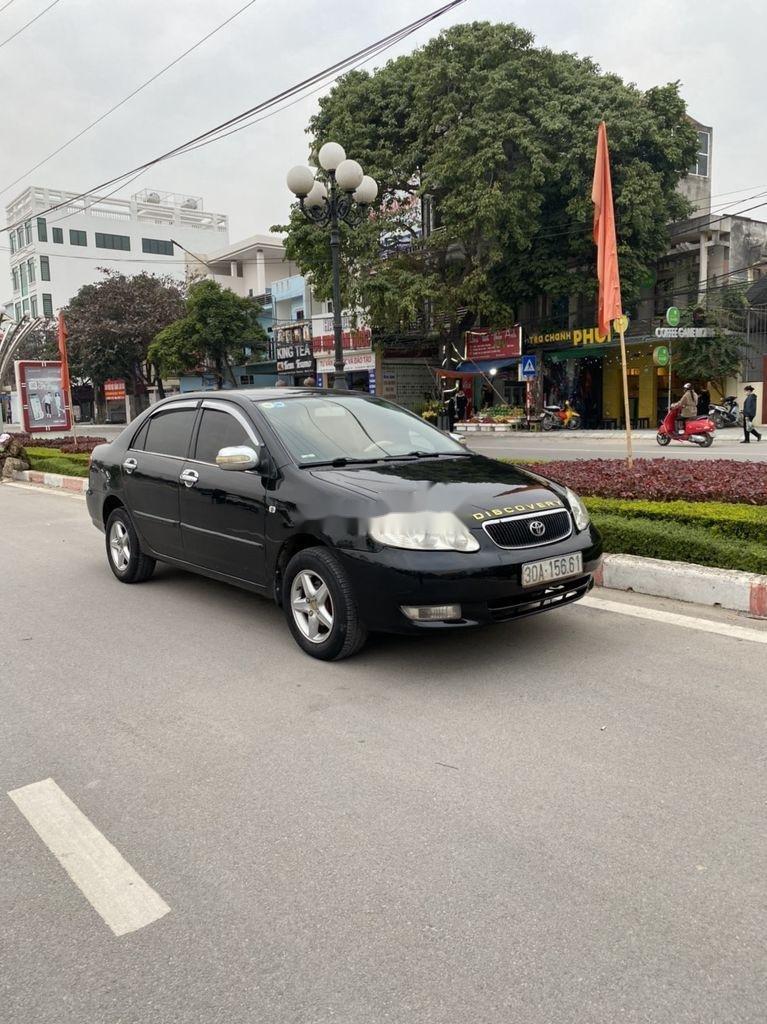 Cần bán lại xe Toyota Corolla Altis đời 2002, màu đen, giá chỉ 198 triệu (1)