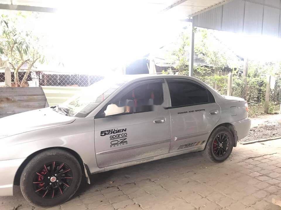 Cần bán lại xe Kia Spectra sản xuất năm 2003, màu bạc  (1)