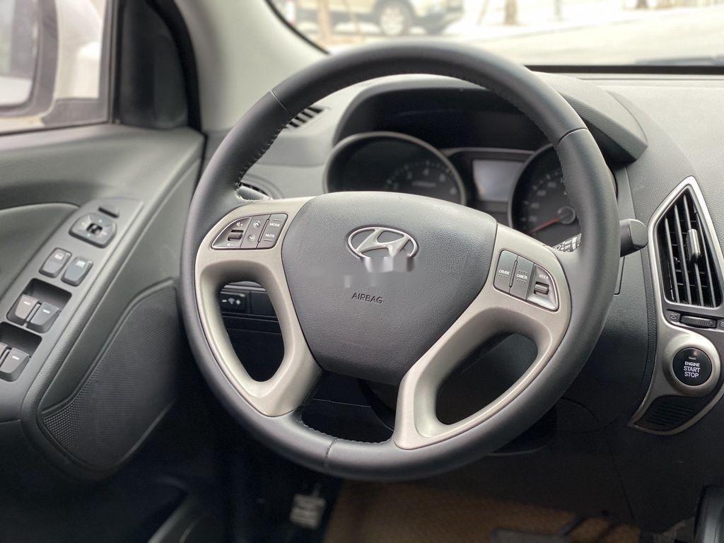 Cần bán gấp Hyundai Tucson đời 2010, màu trắng, xe nhập (9)