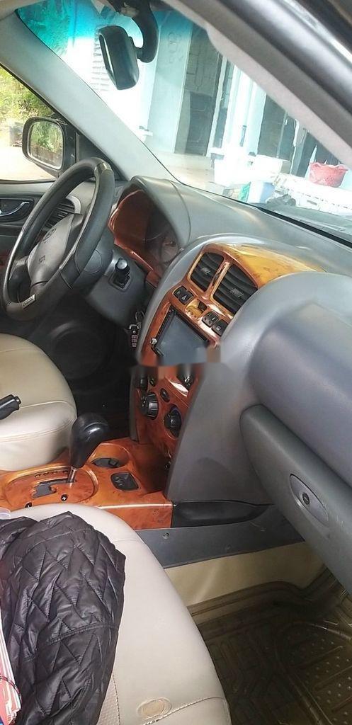 Bán ô tô Hyundai Santa Fe đời 2003, màu đen chính chủ (10)