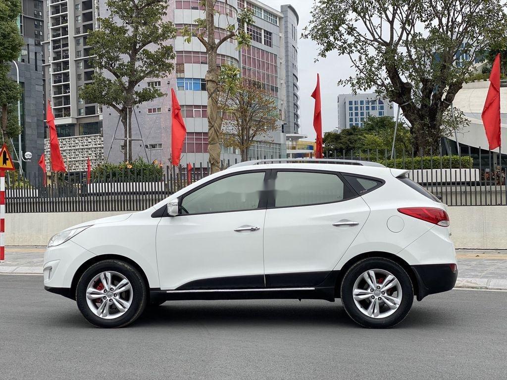 Cần bán gấp Hyundai Tucson đời 2010, màu trắng, xe nhập (3)