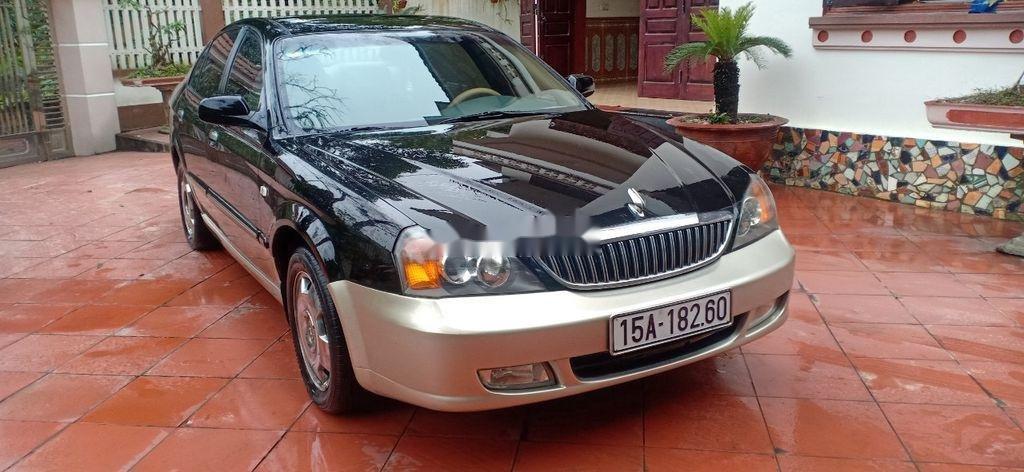 Cần bán lại xe Daewoo Magnus đời 2004, màu đen, 125tr (1)