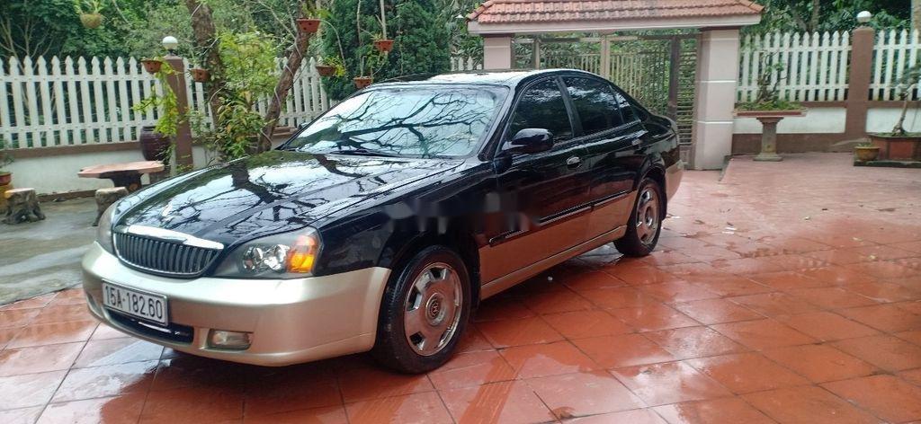 Cần bán lại xe Daewoo Magnus đời 2004, màu đen, 125tr (3)