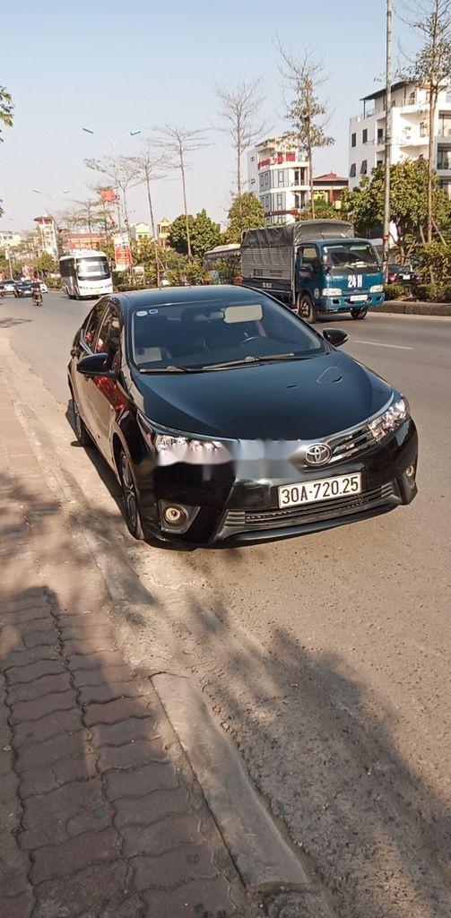 Cần bán gấp Toyota Corolla Altis năm 2015, màu đen còn mới (3)