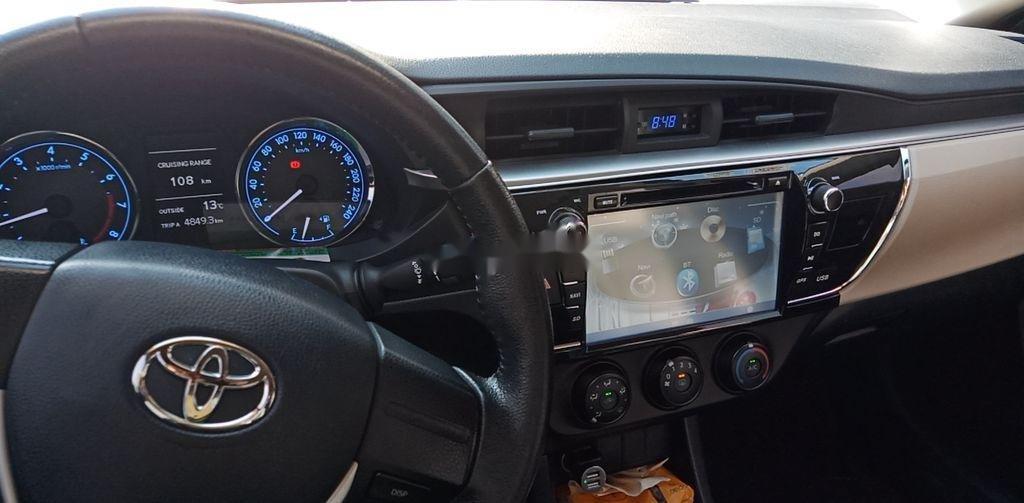 Cần bán gấp Toyota Corolla Altis năm 2015, màu đen còn mới (4)