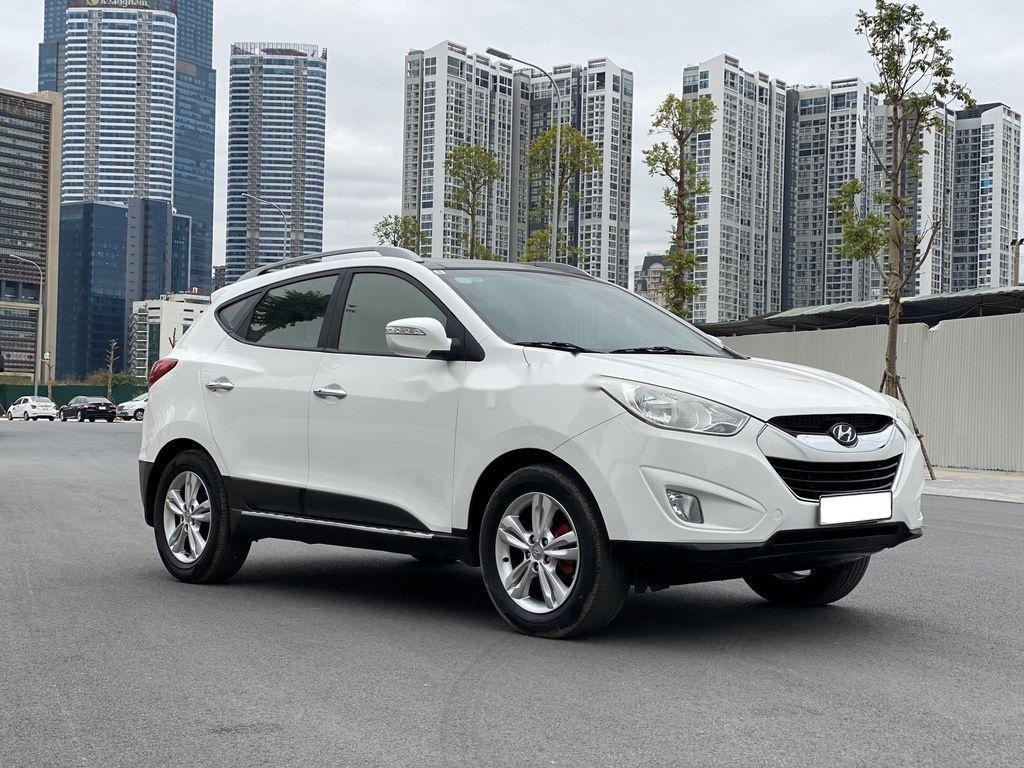 Cần bán gấp Hyundai Tucson đời 2010, màu trắng, xe nhập (2)