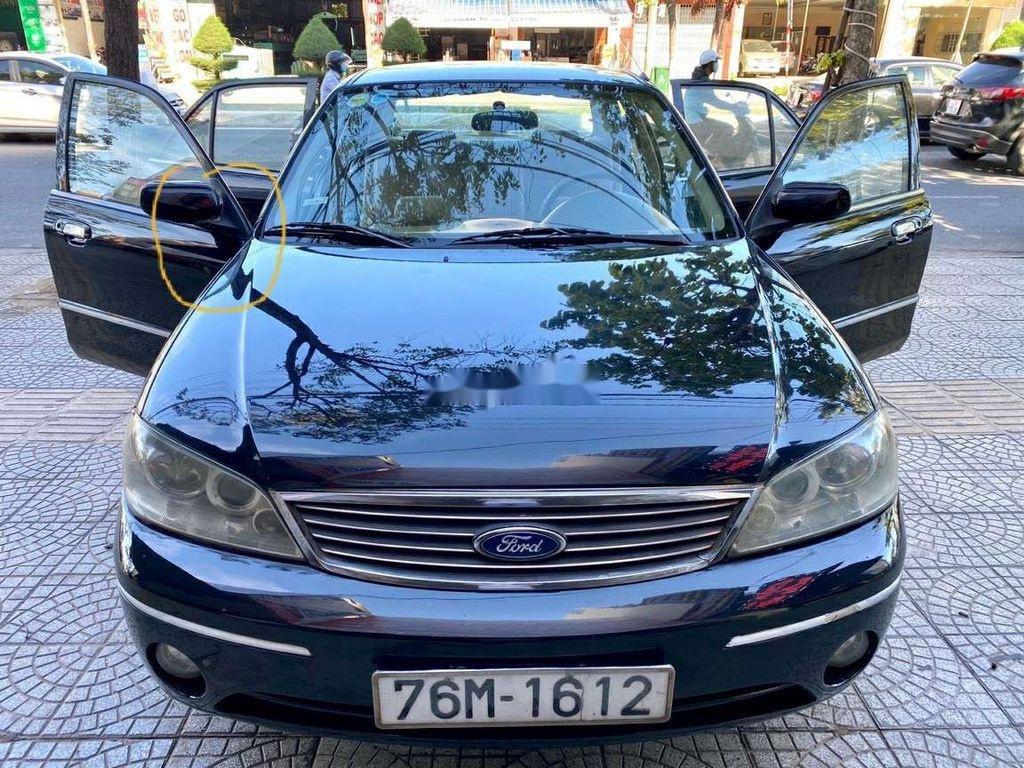 Cần bán lại xe Ford Laser đời 2005, màu đen chính chủ, 165tr (1)