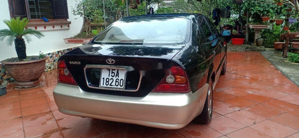Cần bán lại xe Daewoo Magnus đời 2004, màu đen, 125tr (10)