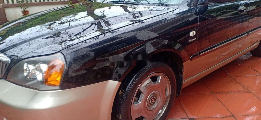 Cần bán lại xe Daewoo Magnus đời 2004, màu đen, 125tr (9)