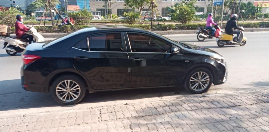 Cần bán gấp Toyota Corolla Altis năm 2015, màu đen còn mới (1)