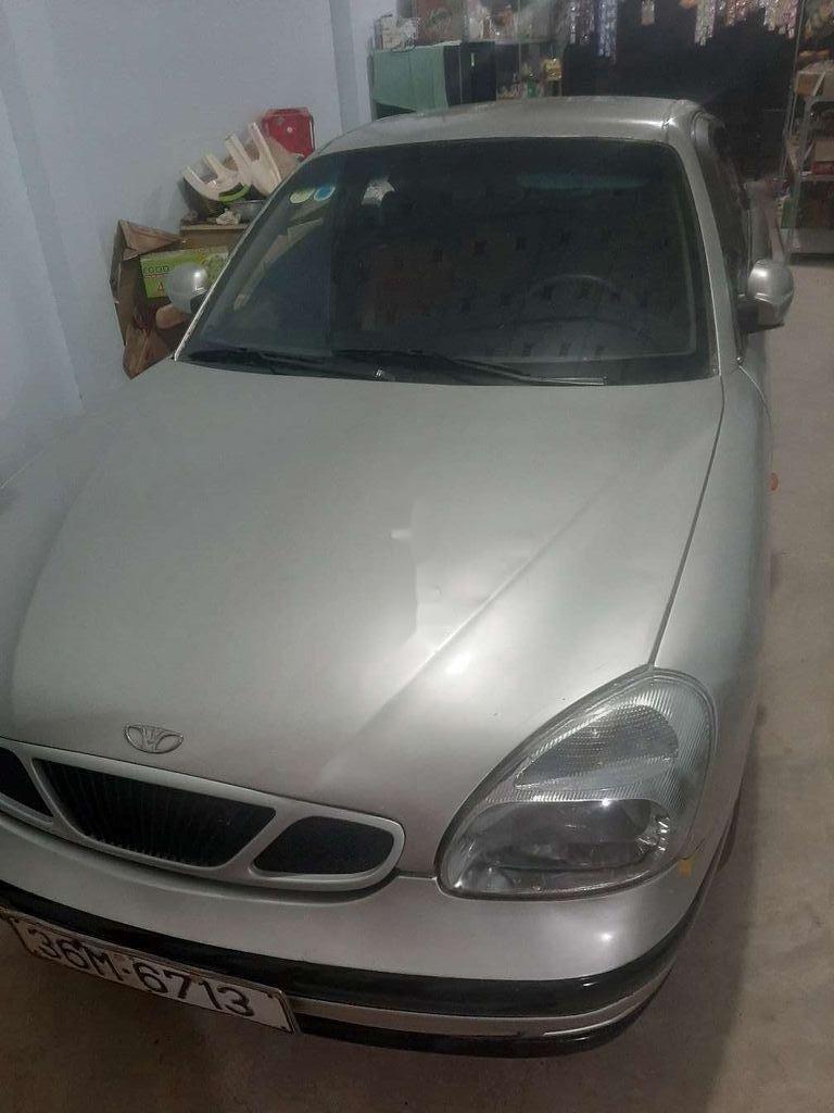 Cần bán Daewoo Nubira sản xuất 2000, màu bạc, xe nhập còn mới (1)