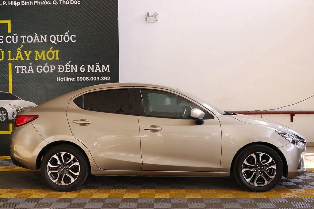 Cần bán gấp Mazda 2 đời 2016, màu vàng, 426tr (4)