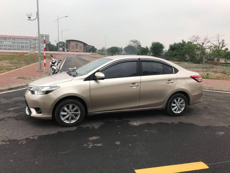 Bán ô tô Toyota Vios năm 2015, màu vàng chính chủ (11)