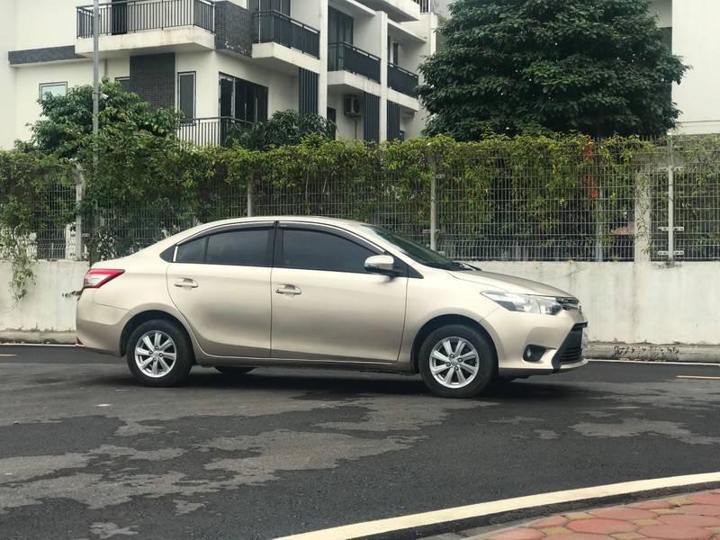 Bán ô tô Toyota Vios năm 2015, màu vàng chính chủ (12)