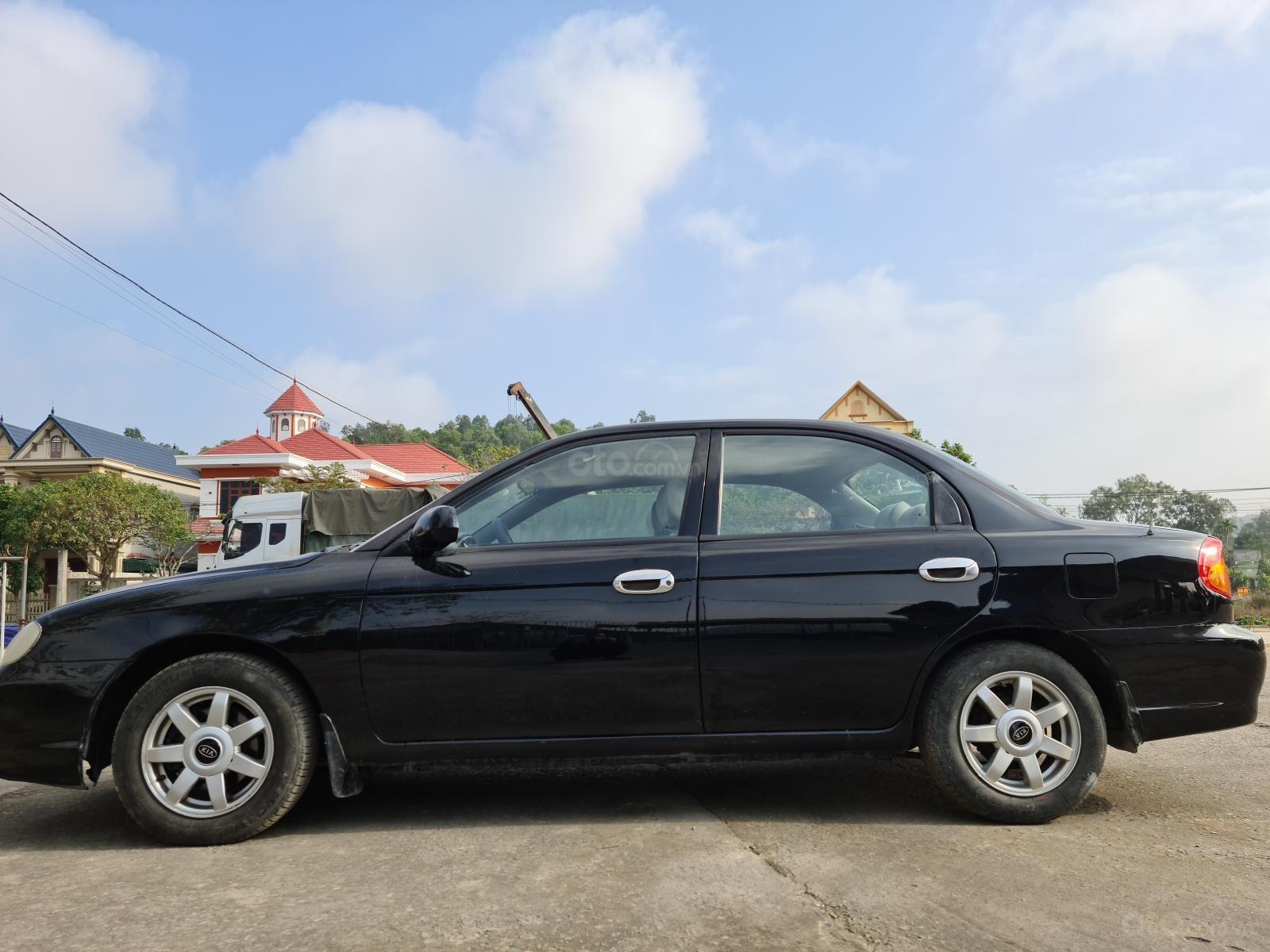 Cần bán lại xe Kia Spectra đăng ký 2004 còn mới giá chỉ 105 triệu đồng (1)