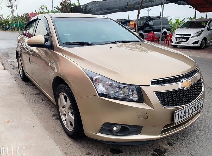 Cần bán xe Chevrolet Cruze đời 2012, màu vàng còn mới (1)
