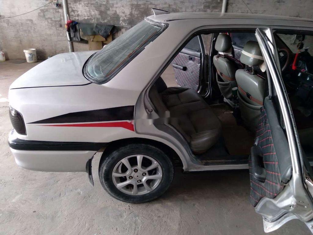 Cần bán Mazda 323 đời 1996, màu bạc, giá 36tr (7)