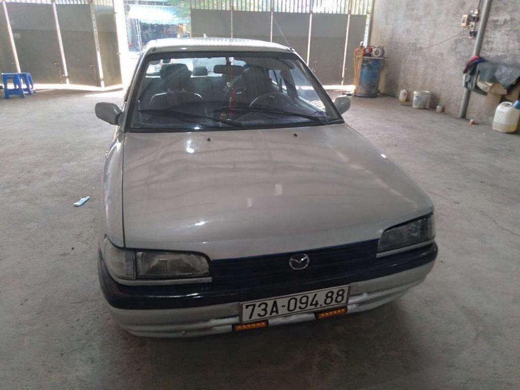 Cần bán Mazda 323 đời 1996, màu bạc, giá 36tr (1)