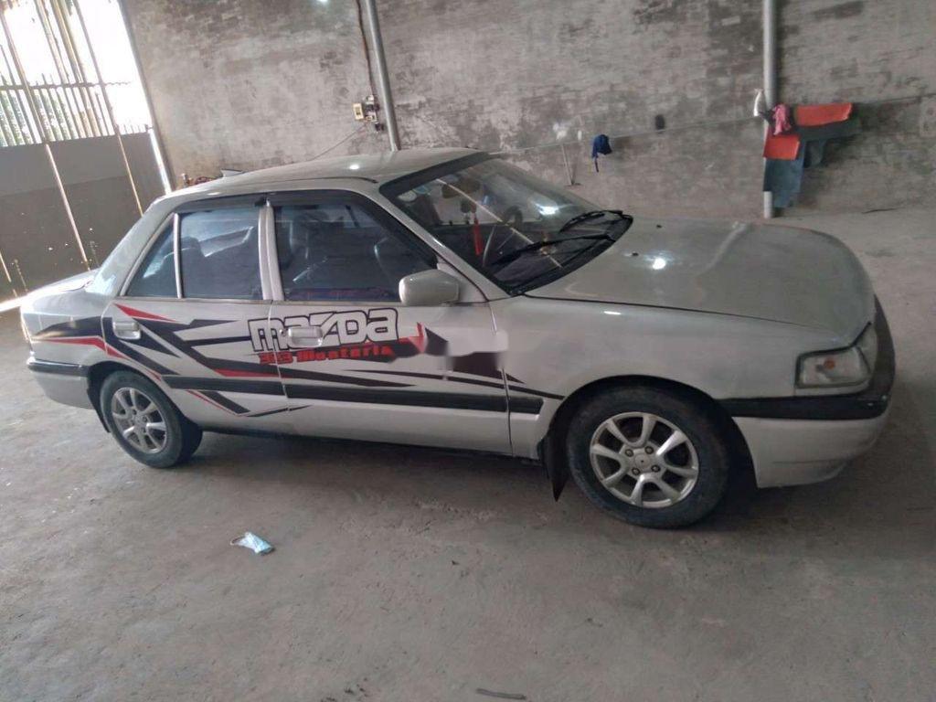 Cần bán Mazda 323 đời 1996, màu bạc, giá 36tr (3)