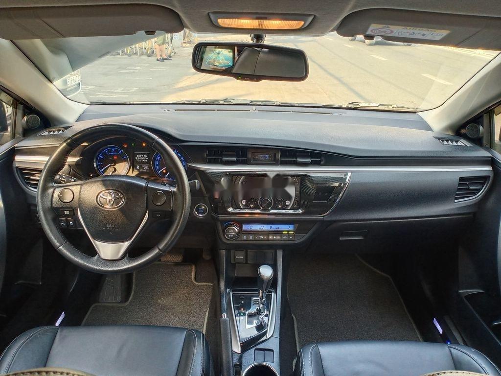 Bán Toyota Corolla Altis năm 2014, màu đen chính chủ, giá chỉ 595 triệu (8)