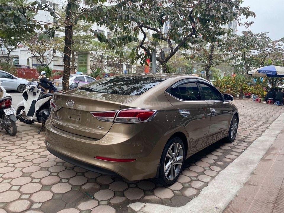 Cần bán Hyundai Elantra 2.0AT sản xuất năm 2016, màu nâu chính chủ (3)
