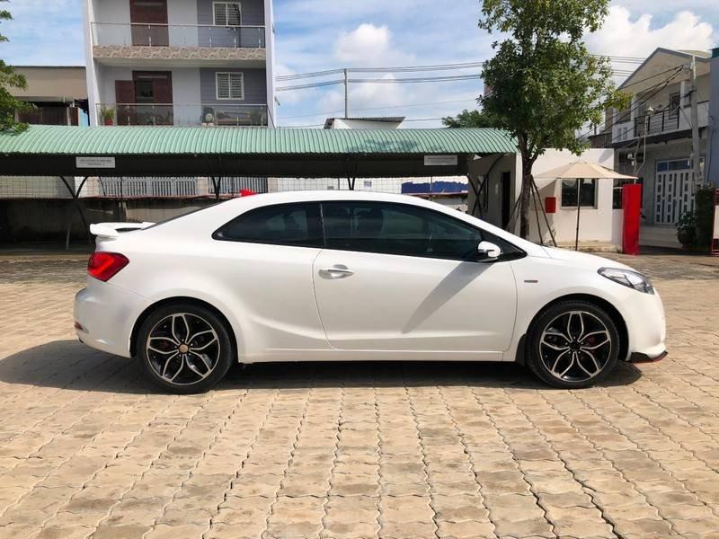 Cần bán Kia Cerato đời 2014, màu trắng, xe nhập chính chủ (5)